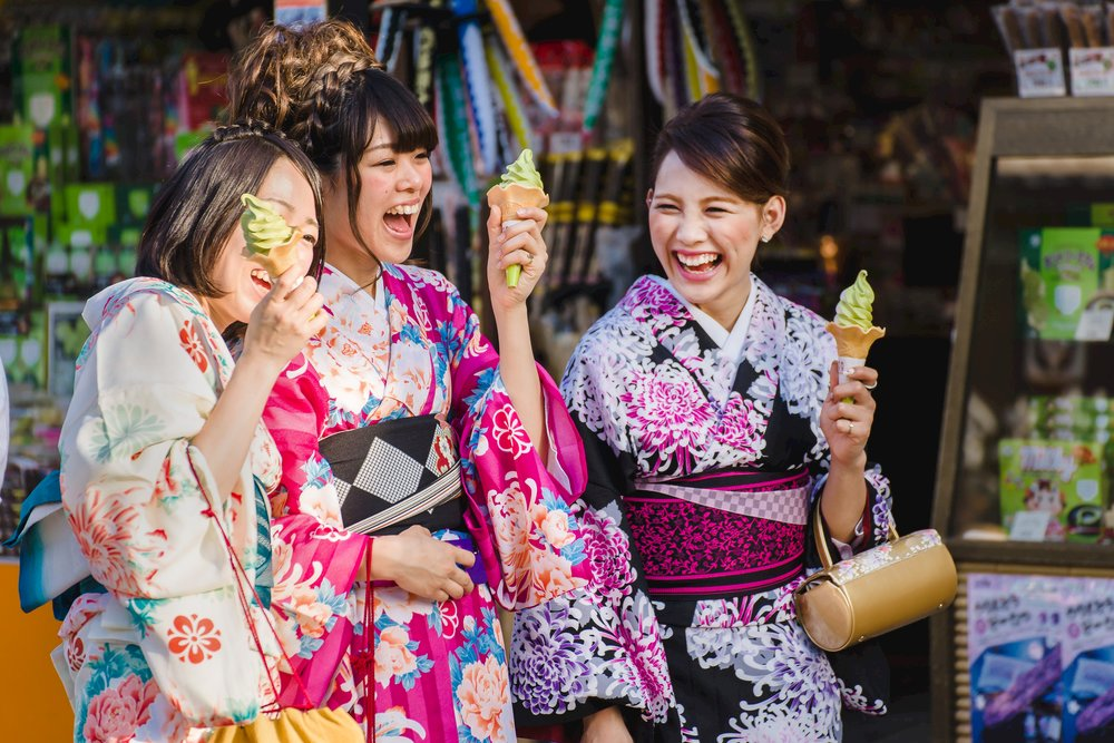Young women enjoying ice cream in the summer